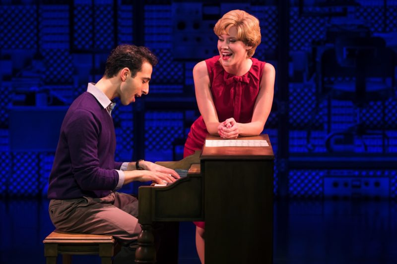 Barry Man plays the piano while Cynthia Weil looks on.